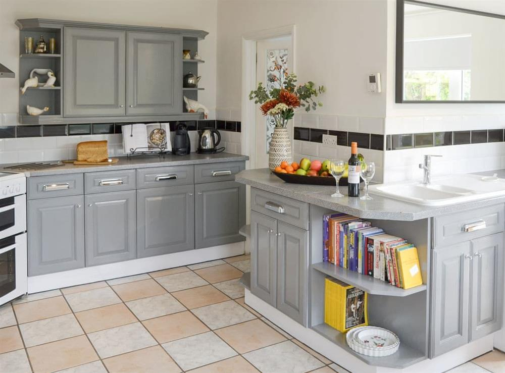 Well-equipped fitted kitchen with dining area at The Boat House in Catfield, near Ludham, Norfolk