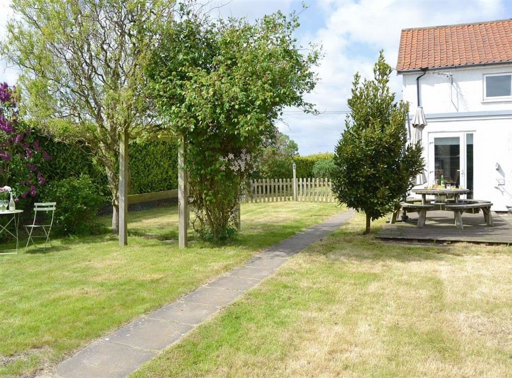 Well-maintained lawned garden at The Boat House in Catfield, near Ludham, Norfolk