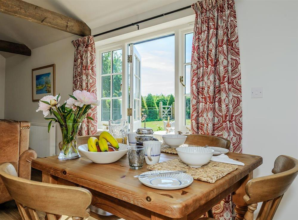 Dining area with French doors at The Bull Pen in Lawford, Essex, England