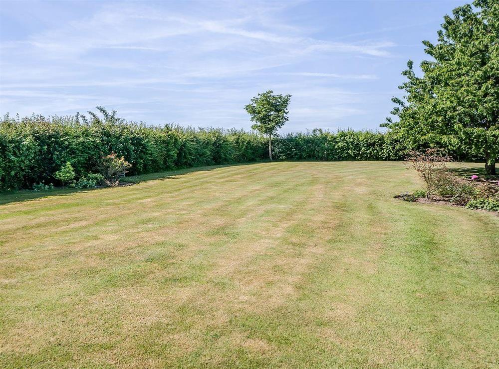 Large lawned garden at The Bull Pen in Lawford, Essex, England
