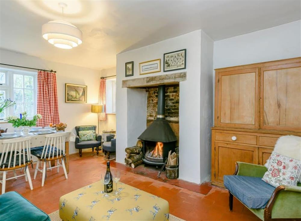 Characterful living/dining room with wood burner at The Buttery in Booton, near Reepham, Norfolk
