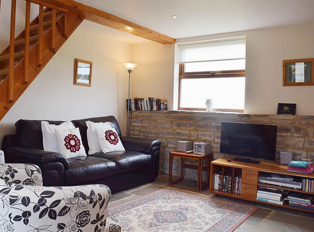 Exposed stonework and woodwork in the cosy and comfortable living area at The Byre in Bidford-on-Avon, Nr Alcester., Warwickshire