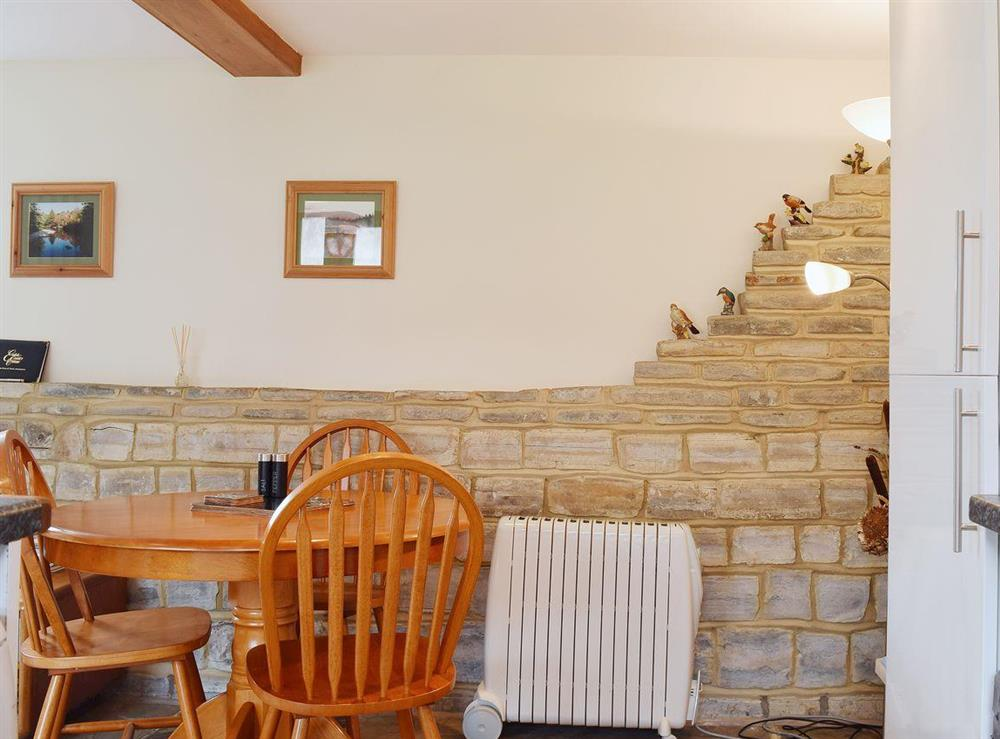 The dining table is between th kitchen area nd the living area at The Byre in Bidford-on-Avon, Nr Alcester., Warwickshire