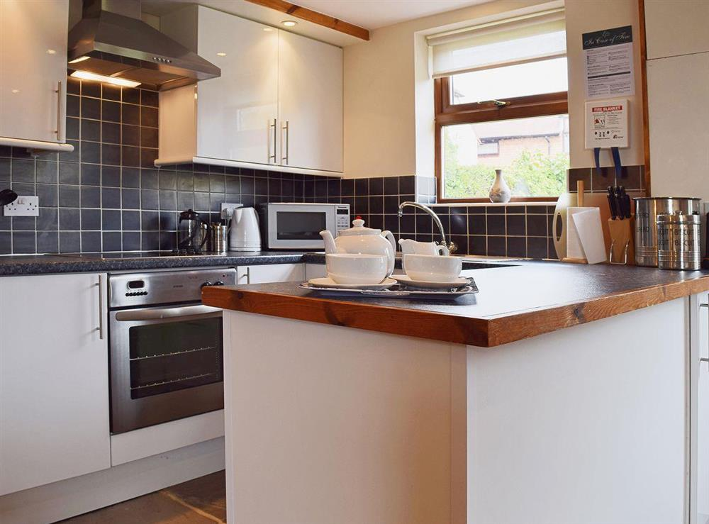 The kitchen area is flag-floored and finished to a high standard at The Byre in Bidford-on-Avon, Nr Alcester., Warwickshire