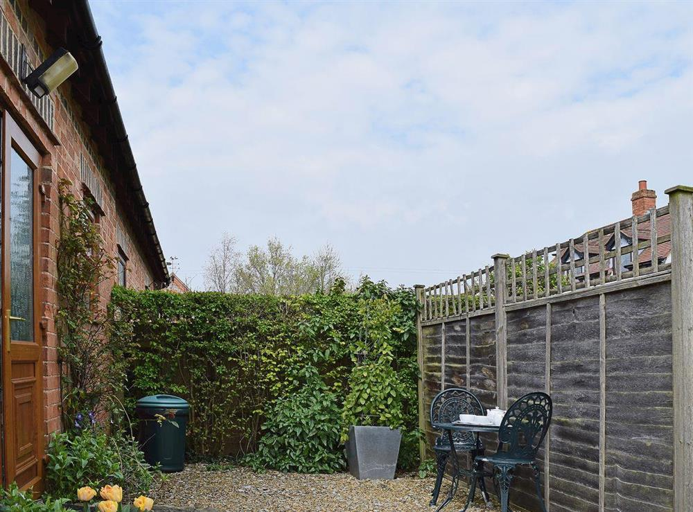 The small private garden area has space set aside for eating outdoors at The Byre in Bidford-on-Avon, Nr Alcester., Warwickshire