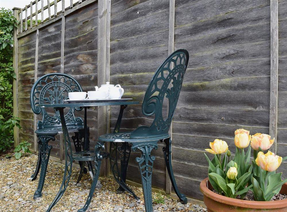 Traditional outdoor furniture is provided for relaxing in the fresh air at The Byre in Bidford-on-Avon, Nr Alcester., Warwickshire