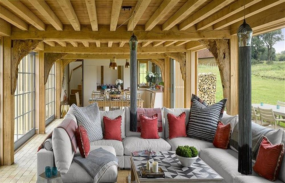 Ground floor:  The spectacular open plan sitting room with kitchen behind at The Cartshed, Sibton Park