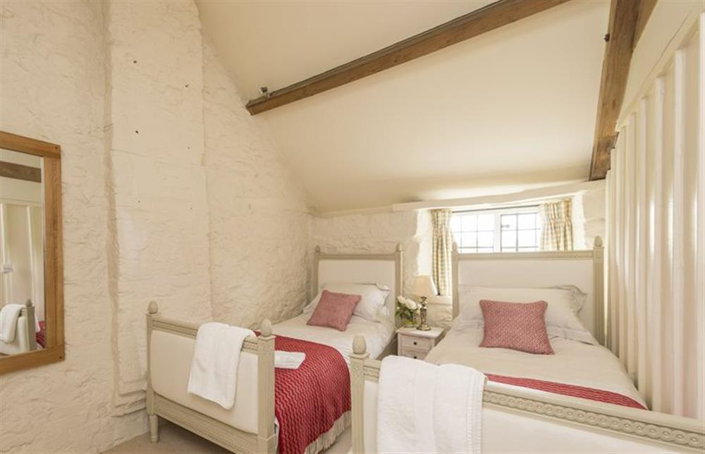 First floor: Bedroom with twin single beds and oak beams at The Cider Mill, Motcombe