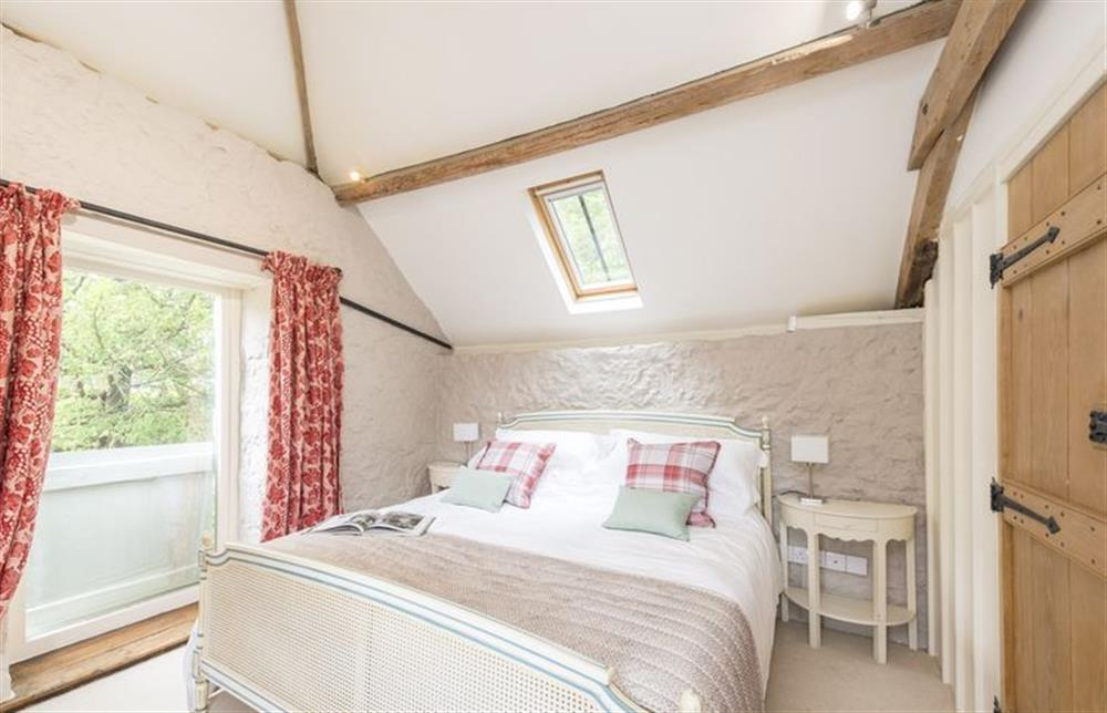First floor: Master bedroom with  king size bed and oak beams at The Cider Mill, Motcombe