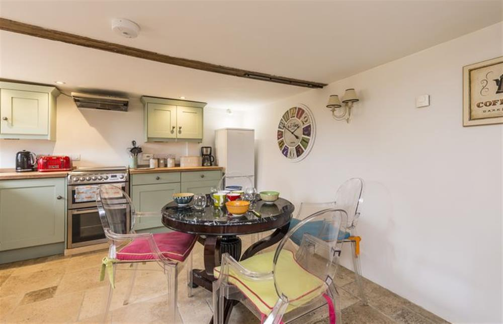 Ground floor: Fully equipped kitchen with dining table and underfloor heating (photo 2) at The Cider Mill, Motcombe