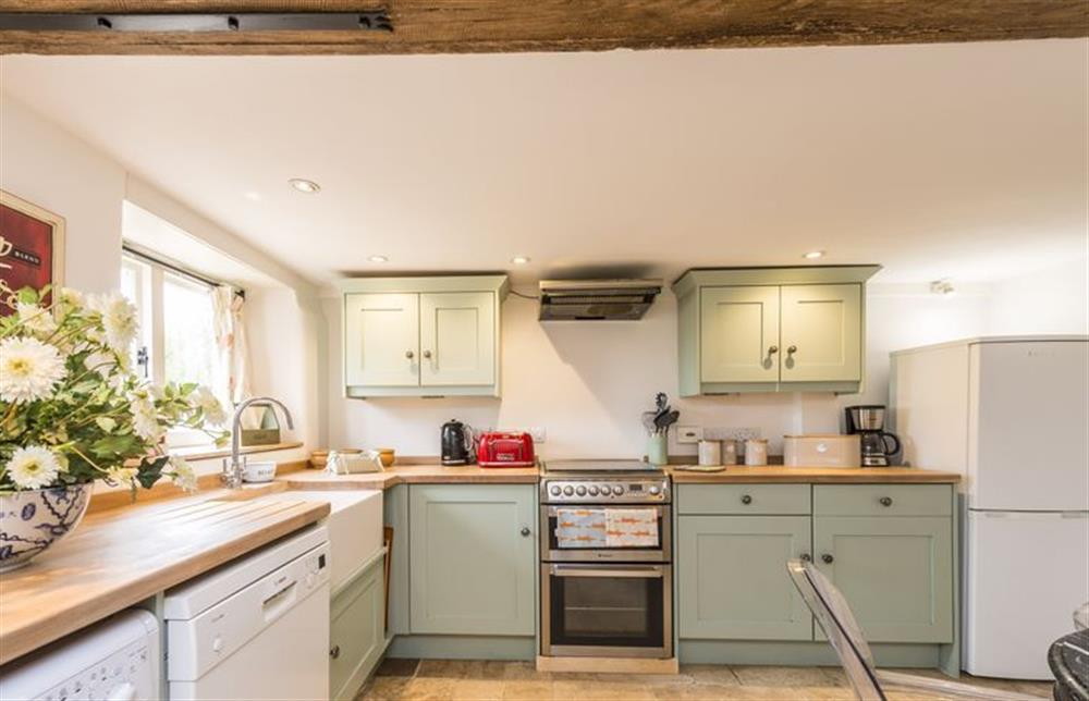 Ground floor: Fully equipped kitchen with dining table and underfloor heating at The Cider Mill, Motcombe
