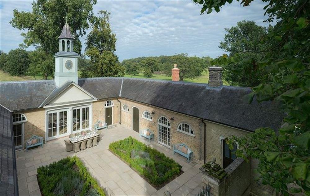 The Clockhouse, a handsome Grade II Listed Georgian former coach house at The Clockhouse, Sibton Park