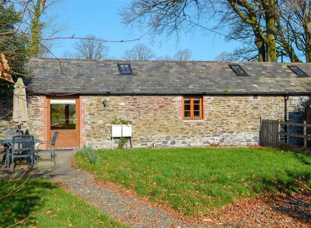 Lawned garden with patio, garden furniture and gas BBQ at The Coach House in Gulworthy, near Tavistock, Devon