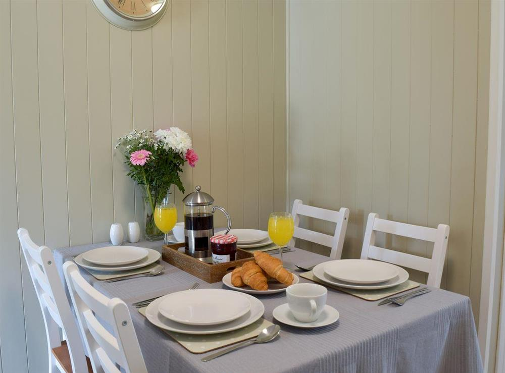Dining area at The Coastal Cottage in Kessingland, Suffolk, England