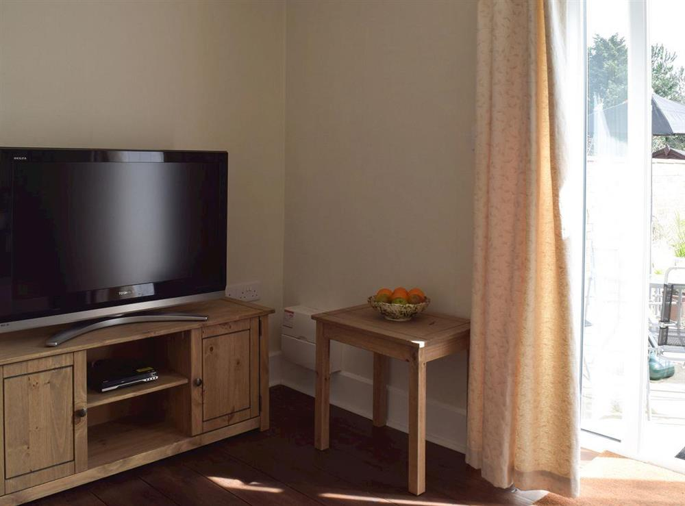 Living room with TV at The Coastal Cottage in Kessingland, Suffolk, England