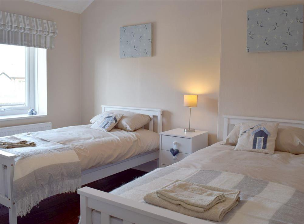 Twin bedroom at The Coastal Cottage in Kessingland, Suffolk, England