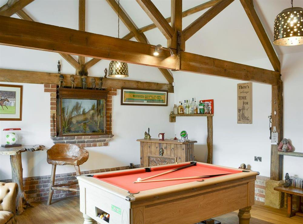 Characterful games room at The Cowshed in Horning, near Wroxham, Norfolk