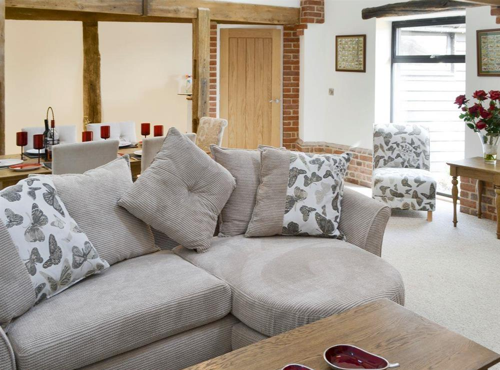 Comfy seating and convenient dining area at The Cowshed in Horning, near Wroxham, Norfolk