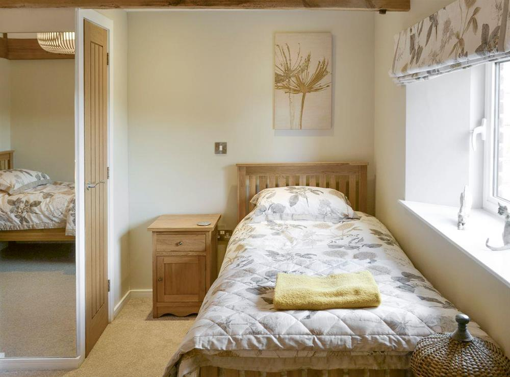 Light and airy twin bedroom at The Cowshed in Horning, near Wroxham, Norfolk