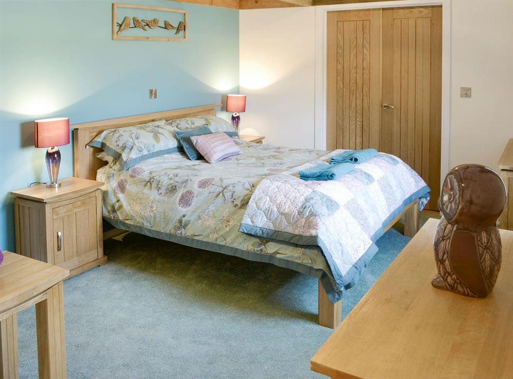 Relaxing double bedroom at The Cowshed in Horning, near Wroxham, Norfolk
