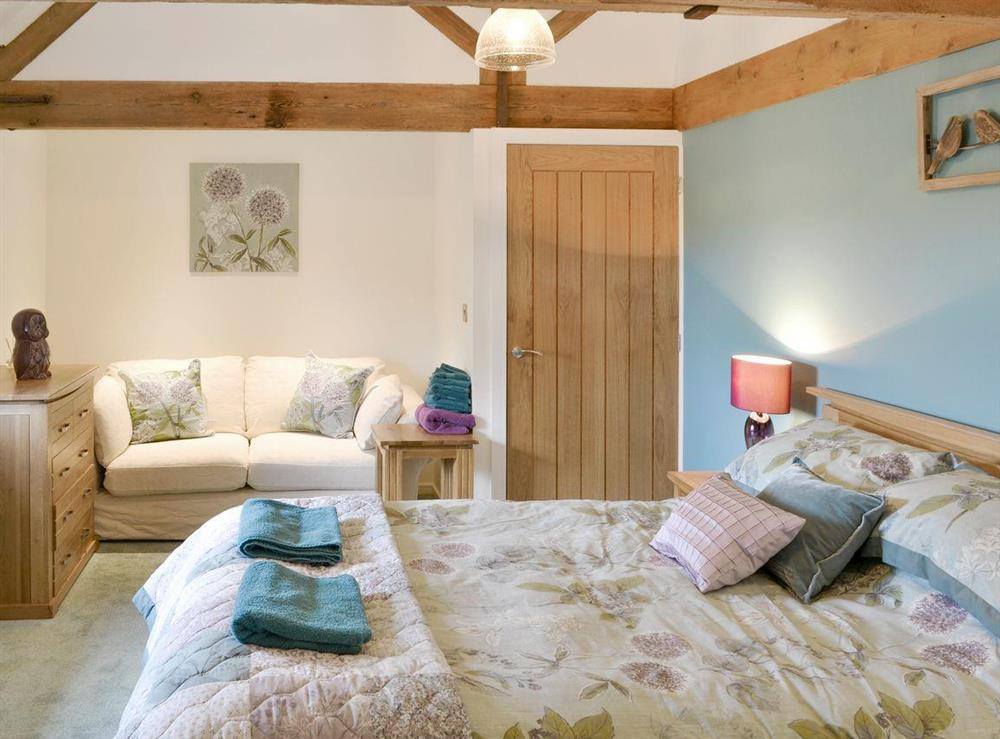 Seating/dressing area within double bedroom at The Cowshed in Horning, near Wroxham, Norfolk