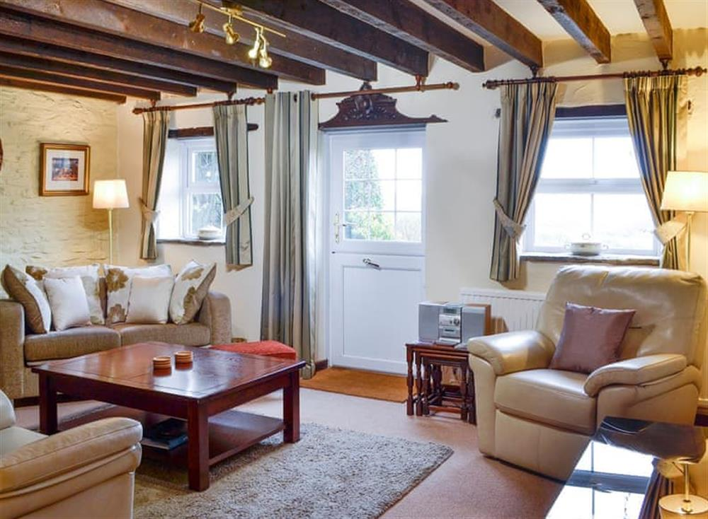 Charming beamed living room at Penny Croft,