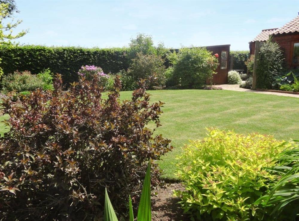 Garden at The Garden Apartment in Neatishead, near Norwich, Norfolk