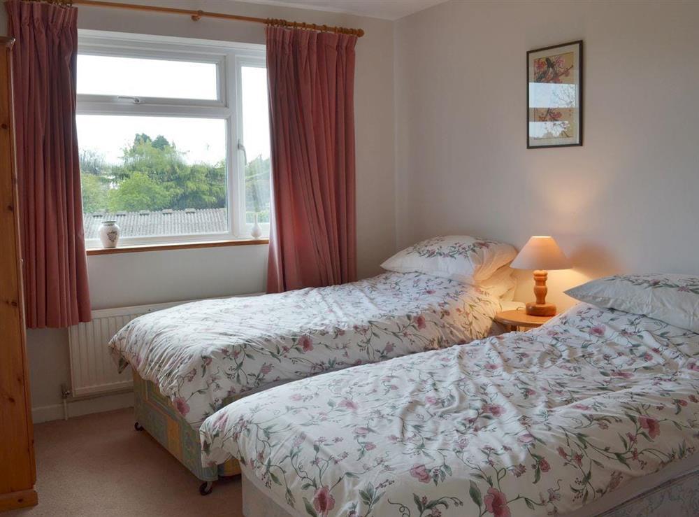 Twin bedroom at The Garden Room in Brixham, Devon