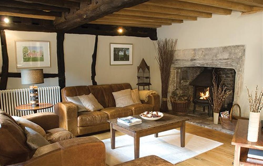 Ground floor: Sitting room with wood burning stove at The Gates, Castle Combe