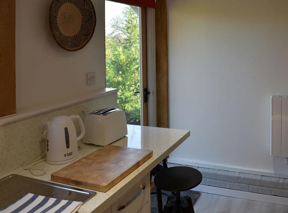 Delightful kitchen with access to the garden at The Hayloft in Wineham, near Henfield, Dorset