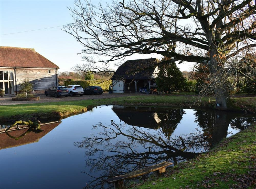 Discrete holiday accommodation overlooking a calming ornamental lake at The Hayloft in Wineham, near Henfield, Dorset