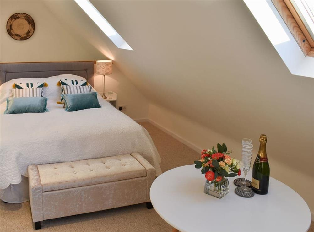 Welcoming double bed at The Hayloft in Wineham, near Henfield, Dorset