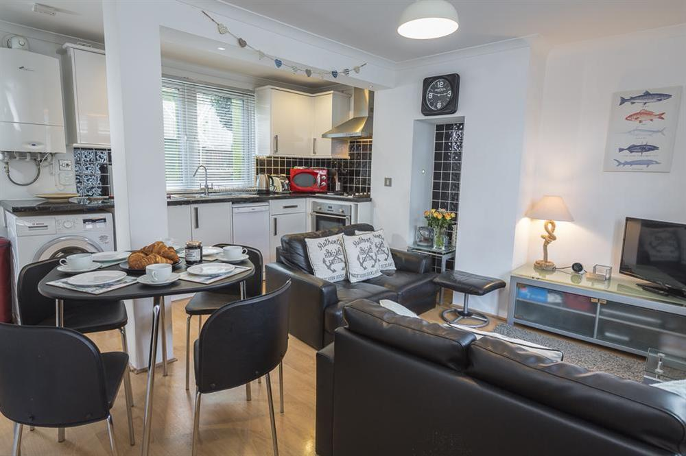 Open plan living, dining and kitchen areas at The Hideaway in , Dartmouth