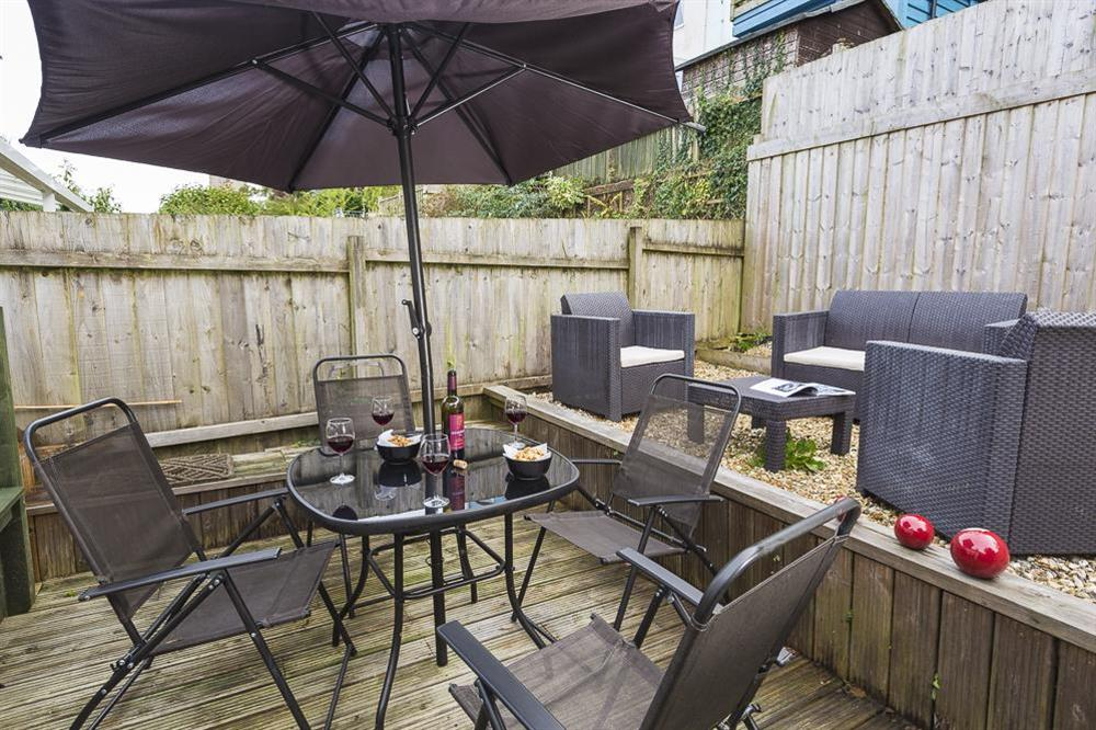 Sunny decking with a bistro table and four chairs