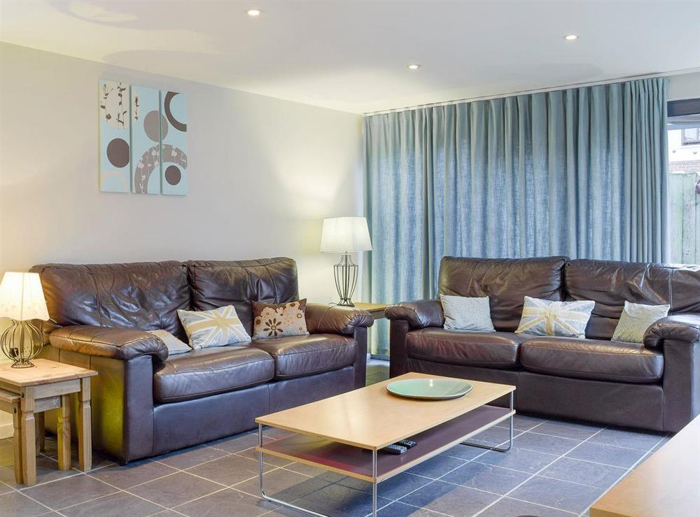Comfy seating within living area at The Joinery in Ledbury, Herefordshire