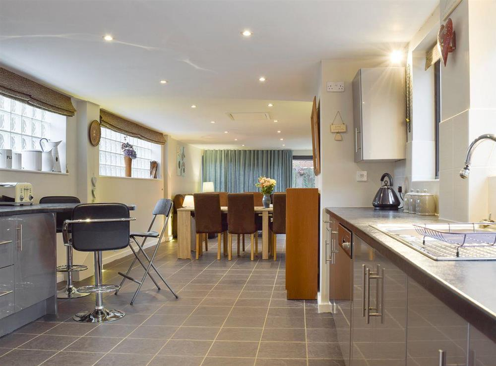 Open aspect from kitchen to convenient dining area at The Joinery in Ledbury, Herefordshire