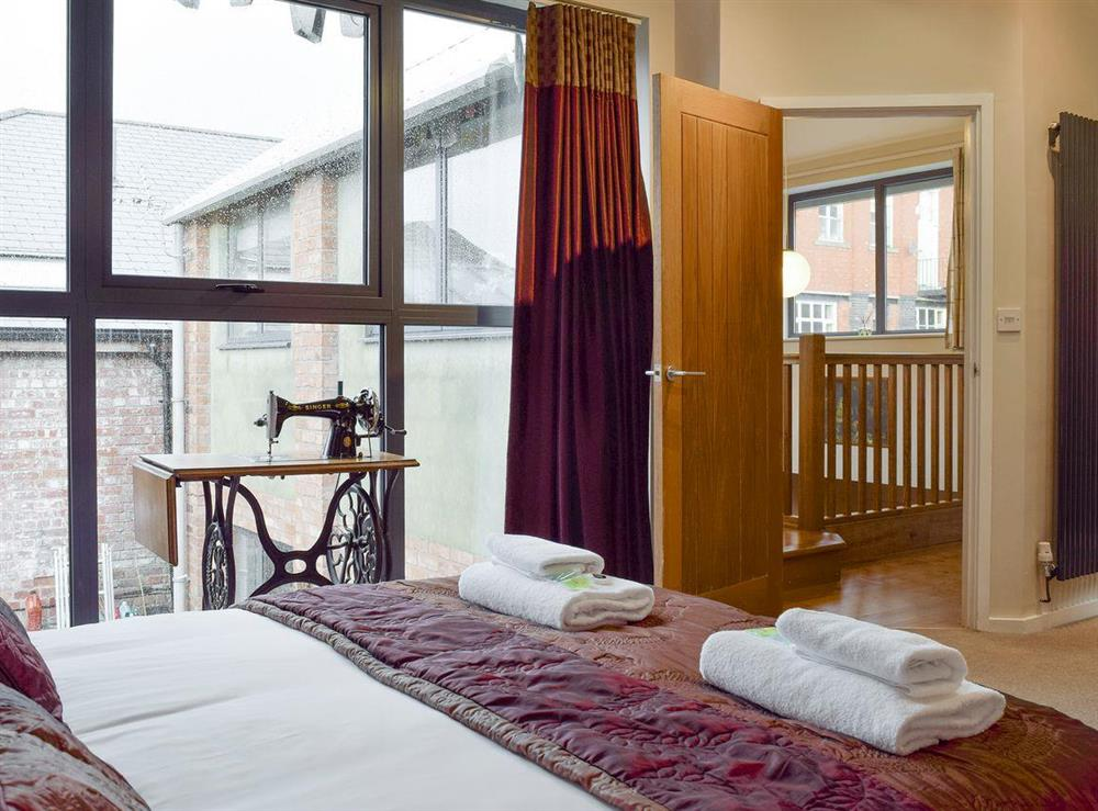 Relaxing master bedroom at The Joinery in Ledbury, Herefordshire