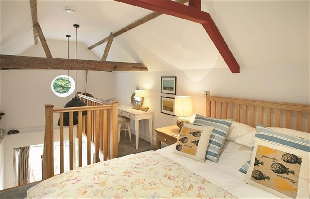 First floor: Mezzanine bedroom on upper level with king size bed (photo 2) at The Maltings, Trunch