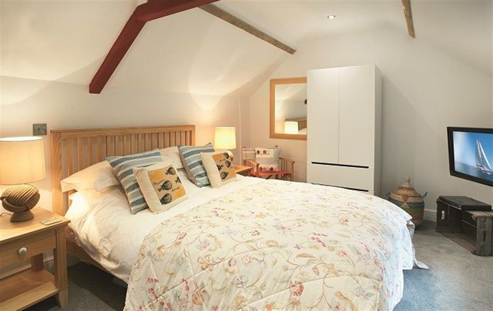 First floor: Mezzanine bedroom on upper level with king size bed at The Maltings, Trunch