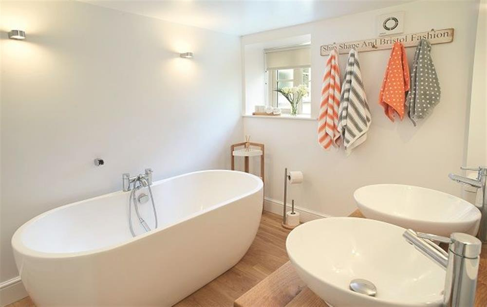Ground floor:  Bathroom with wc, bath with handheld shower and twin basins at The Maltings, Trunch