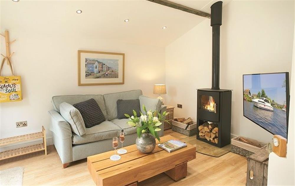Ground floor:  Sitting room with wood burning stove at The Maltings, Trunch