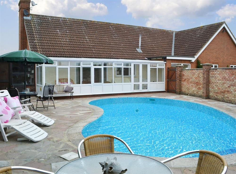Detached holiday home with heated swimming pool at The Nest in Aylsham, Norfolk, England