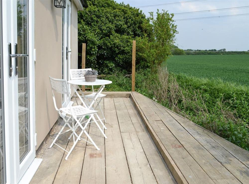 Seating area with views of the open countryside at The Nook in Clavering, near Saffron Waldon, Essex