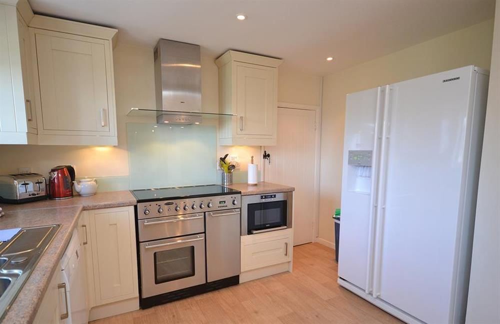 The kitchen boasts a range oven as well as an American fridge freezer at The Old  Bakehouse, Dittisham