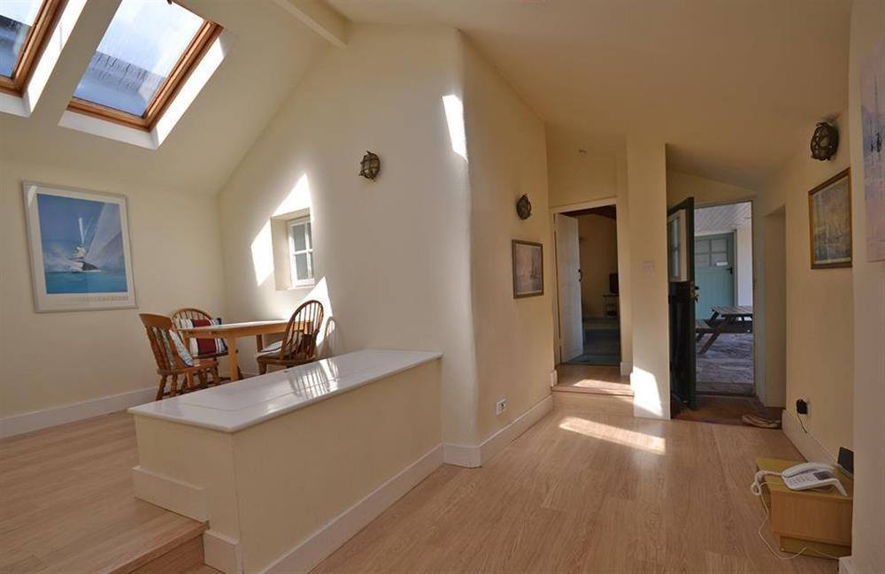 The light and airy entrance hall which incorporates a play area with toy box at The Old  Bakehouse, Dittisham