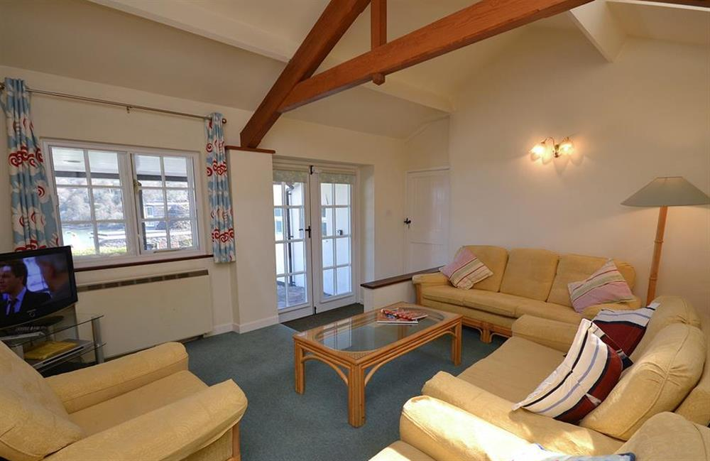 The sitting room has doors opening onto the verandah at The Old  Bakehouse, Dittisham