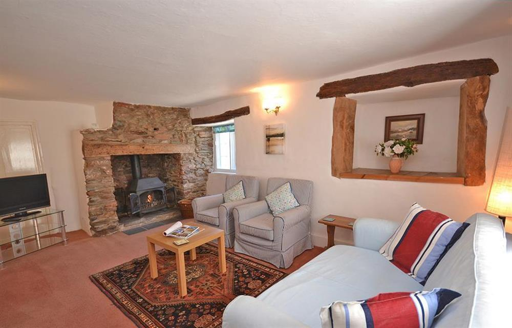 The 'winter' sitting room with a wood burning stove at The Old  Bakehouse, Dittisham