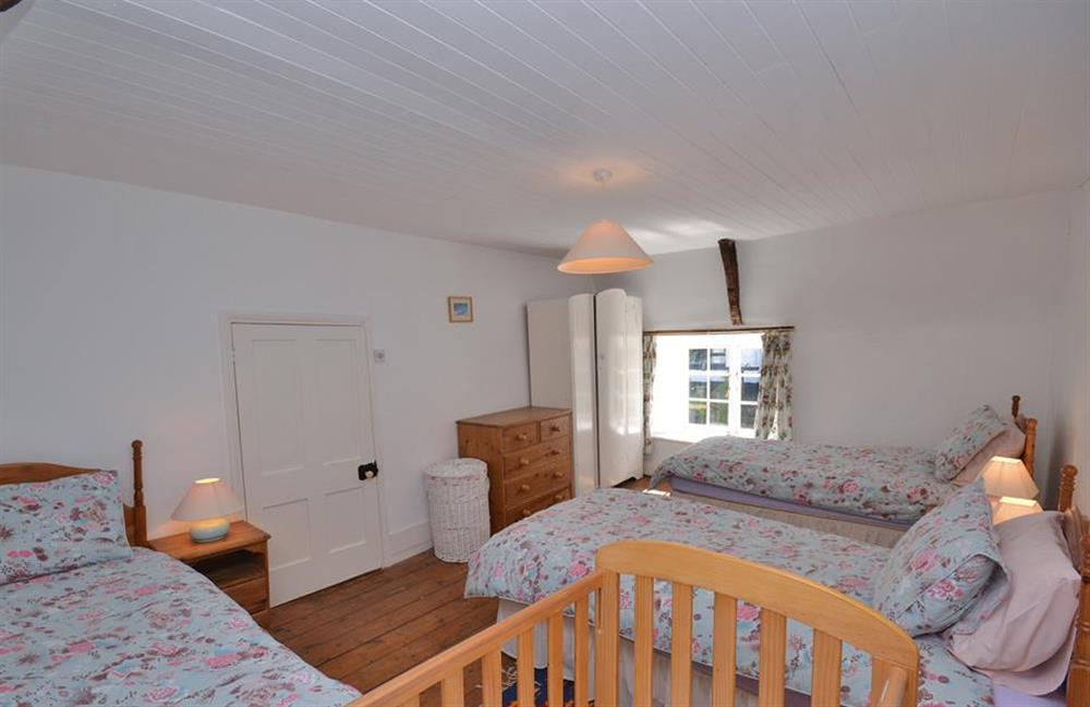 There is plenty of space for a cot in the triple bedroom at The Old  Bakehouse, Dittisham