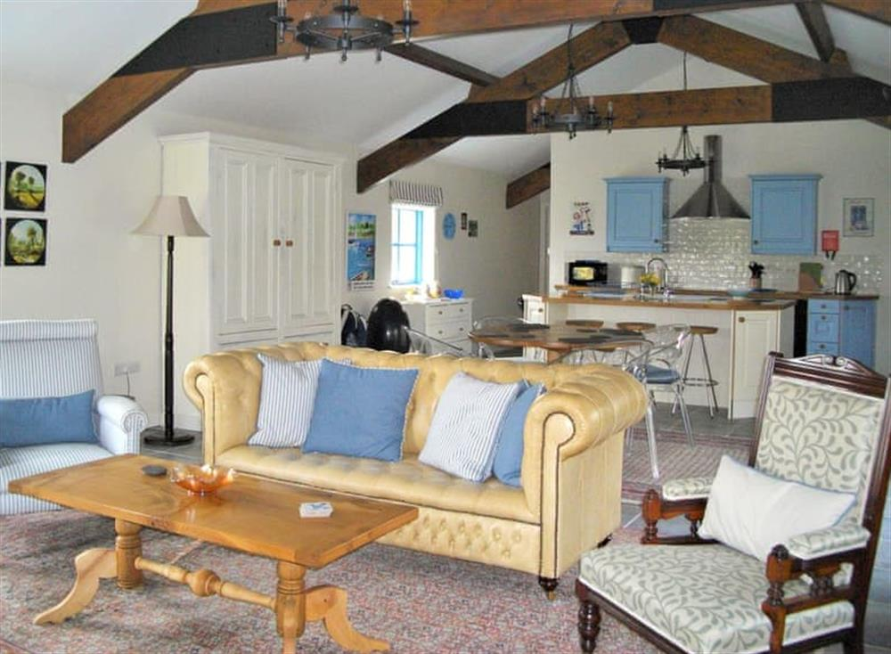 Convenient open-plan design with characterful exposed beams