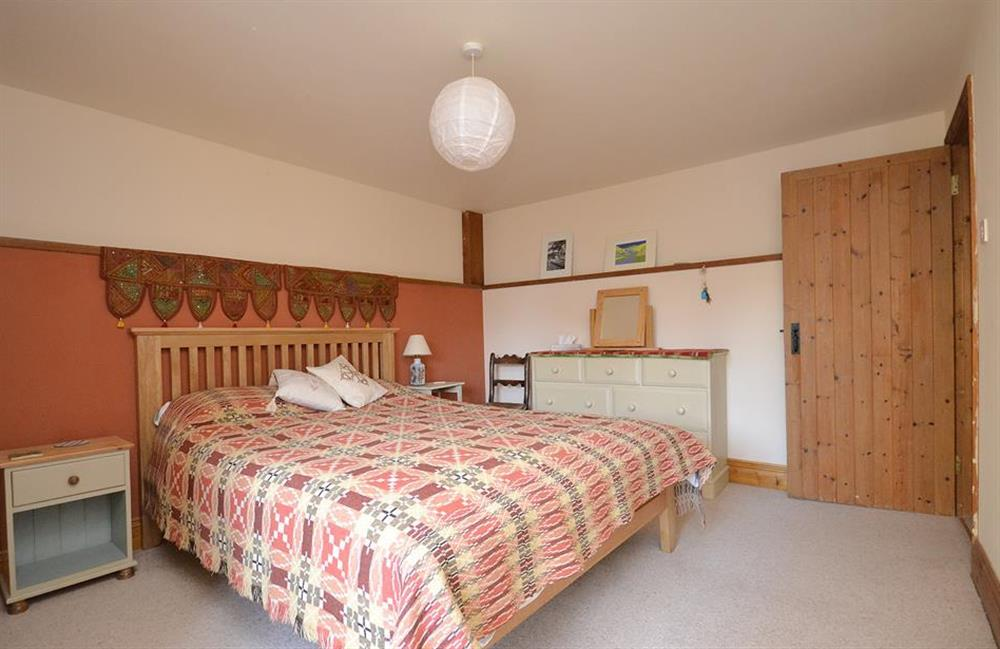 The large master bedroom with king size bed at The Old Dairy, East Allington